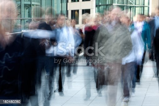 1146224410istockphoto Crowd of Business Commuters, Blurred Motion 182480280