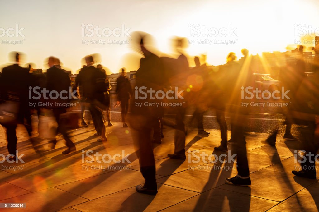Crowd of business people at sunset, London, England stock photo