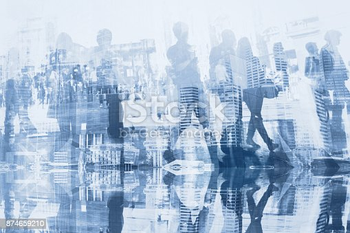 istock crowd of business people commuters double exposure 874659210
