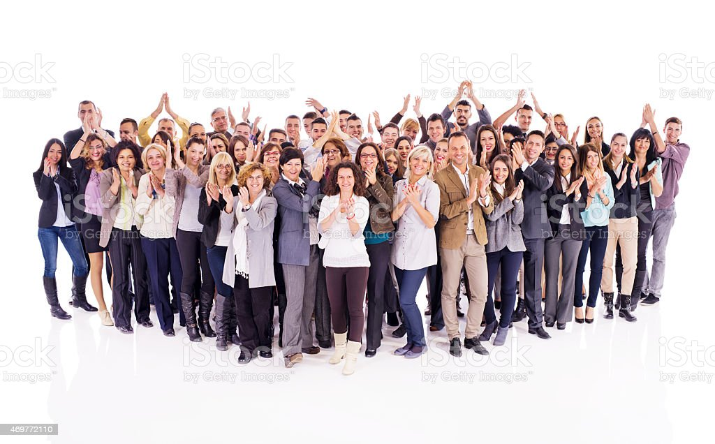 Crowd of cheerful business people applauding and looking at camera. stock photo