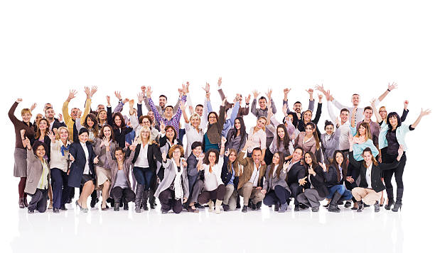 Crowd of cheerful business people with raised hands. stock photo