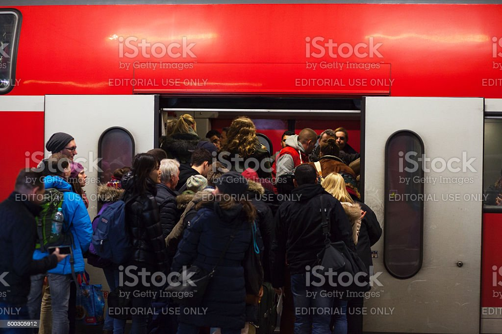 Crowd of commuters at train stock photo