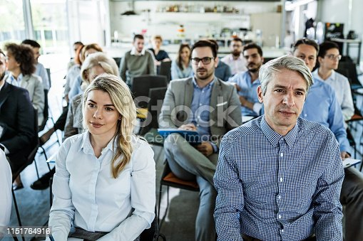 istock Crowd of entrepreneurs attending a business seminar in board room. 1151764916