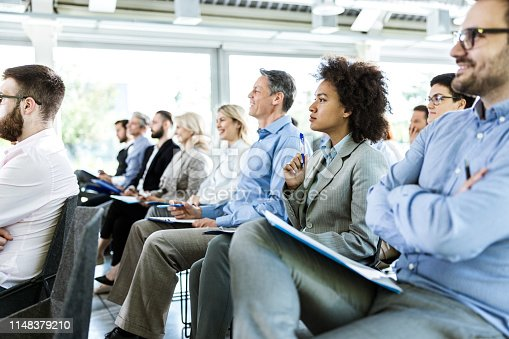 istock Crowd of entrepreneurs paying attention on business seminar in board room. 1148379210