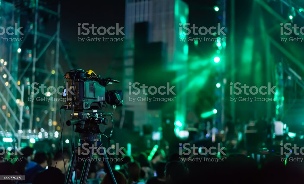 Crowd of hands up concert stage lights and people fan audience silhouette raising hands in the music festival rear view with spotlight glowing effect stock photo