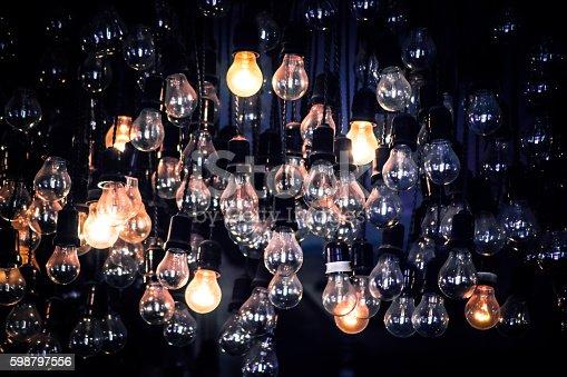 istock Crowd of Hanging Light Bulbs, Idea concept 598797556