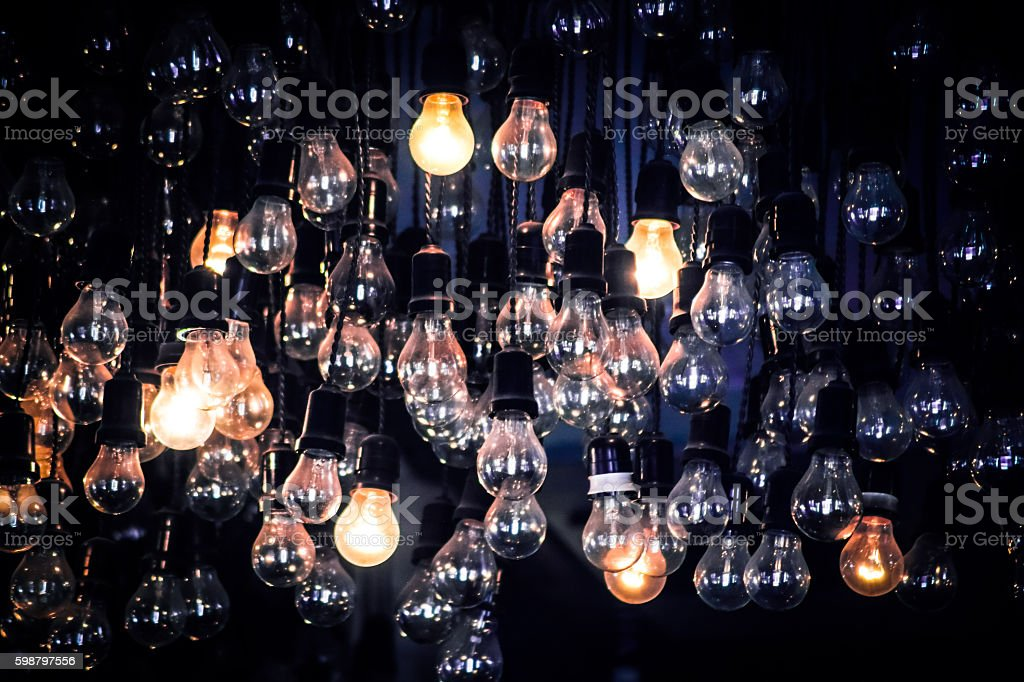 Crowd of Hanging Light Bulbs, Idea concept stock photo