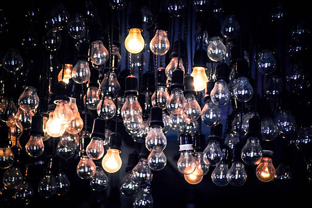 Crowd of Hanging Light Bulbs, Idea concept - Photo