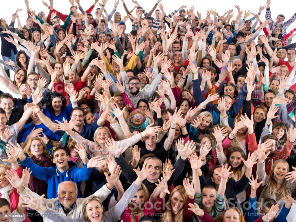 High angle view of large group of cheerful people with their arms...