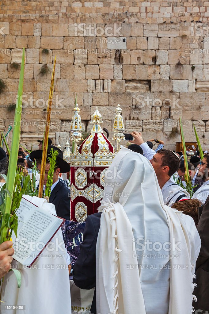 Crowd of Jewish worshipers in white wearing stock photo