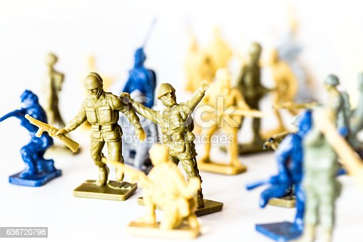 istock Crowd of little soldier toy in selective focus war concept 636720798