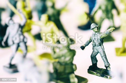 istock Crowd of little soldier toy in selective focus war concept 636720946