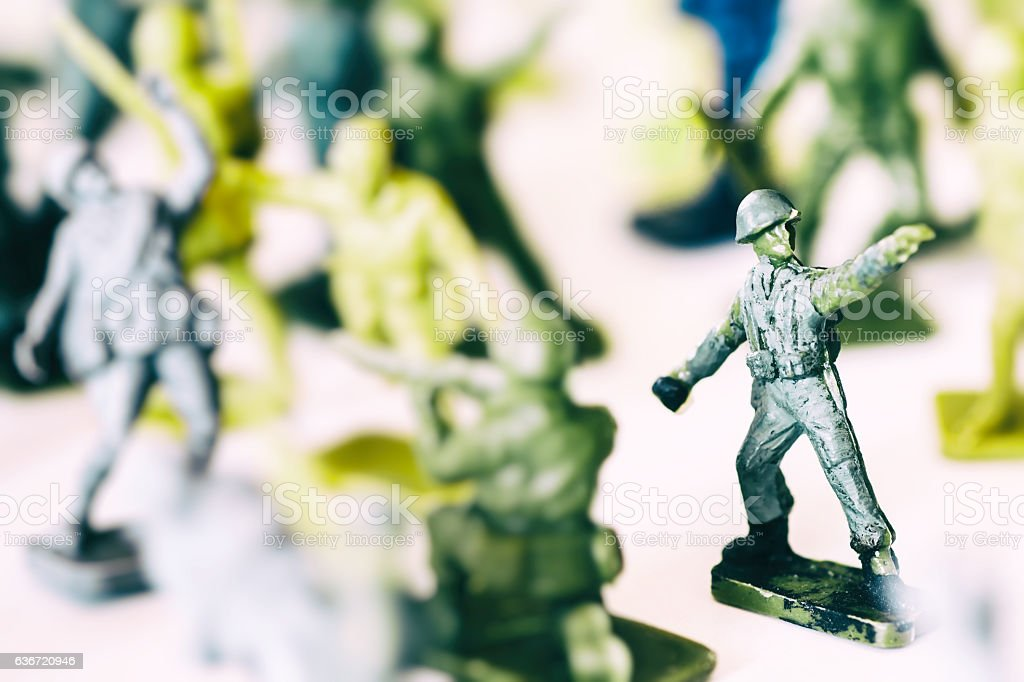 Crowd of little soldier toy in selective focus war concept stock photo