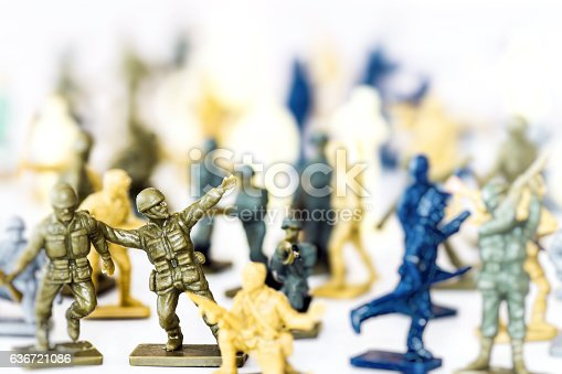 istock Crowd of little soldier toy in selective focus war concept 636721086