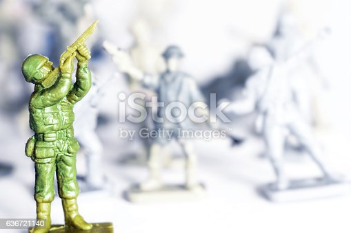 istock Crowd of little soldier toy in selective focus war concept 636721140