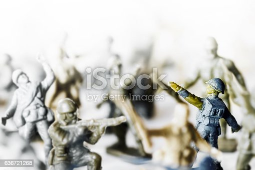 istock Crowd of little soldier toy in selective focus war concept 636721268