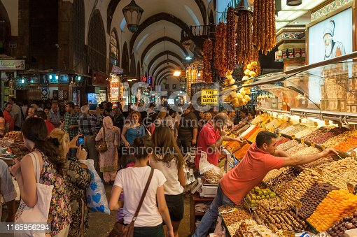 Istanbul, Turkey - August 27, 2013: Crowd of multi-ethnic people shopping at Grand Bazaar market in Istanbul