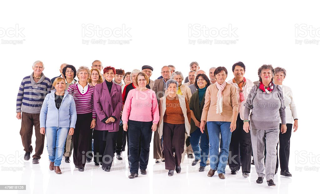 Crowd of old people walking towards the camera. stock photo