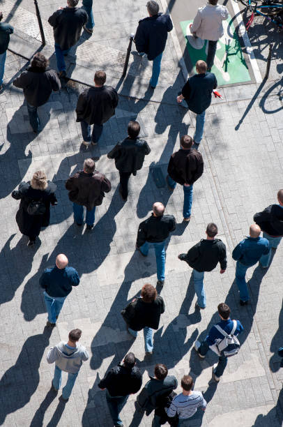 Crowd of Pedestrians Walking from Above stock photo