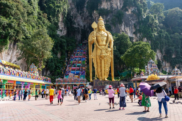Crowd of people at Batu Caves temple Kuala Lumpur, Malaysia - September 23, 2018: Crowd of people visiting the Batu Caves, a Hinduism temple located in Kuala Lumpur kuala lumpur batu caves stock pictures, royalty-free photos & images