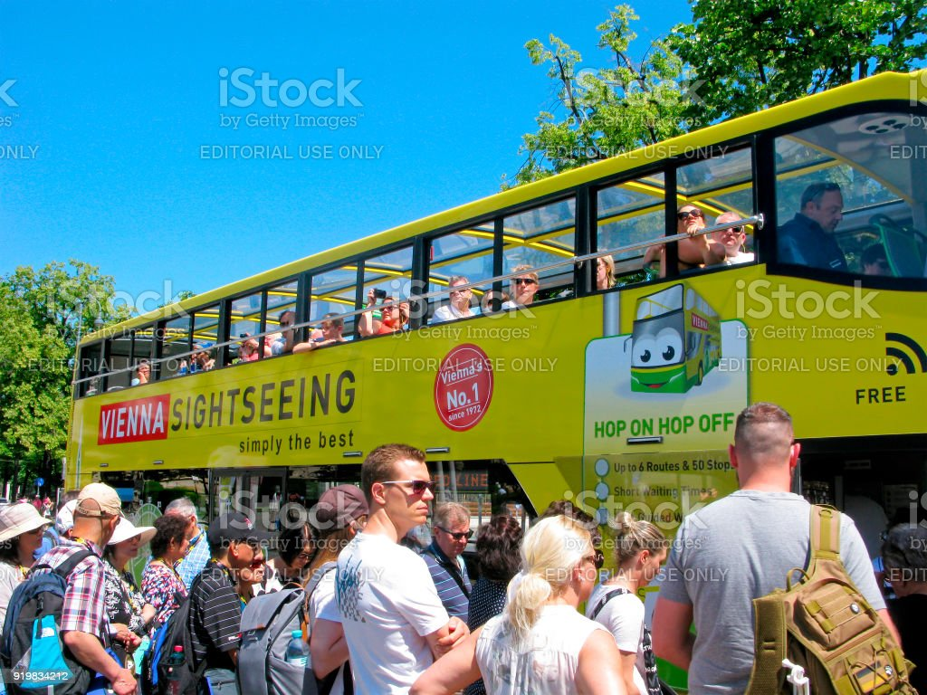 Crowd of people, bus stop, tourists in Vienna