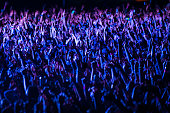 istock Crowd of people cheering at a music festival at night 1222628897