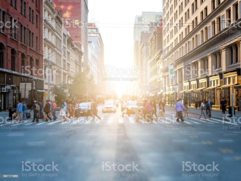 Crowd of people crossing street in New York City