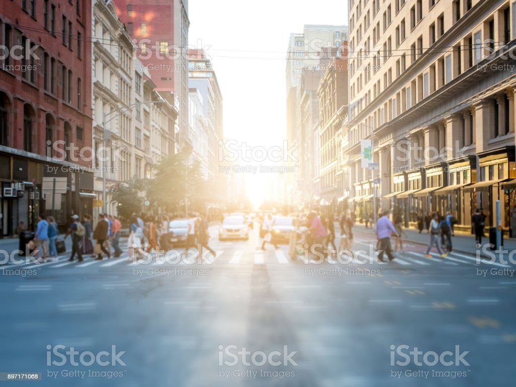 Crowd of people crossing street in New York City stock photo
