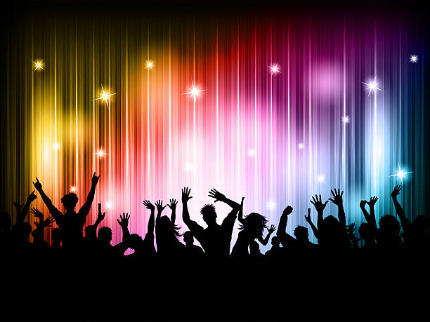 crowd of people dancing on a colorful background - disco lights stock photos and pictures