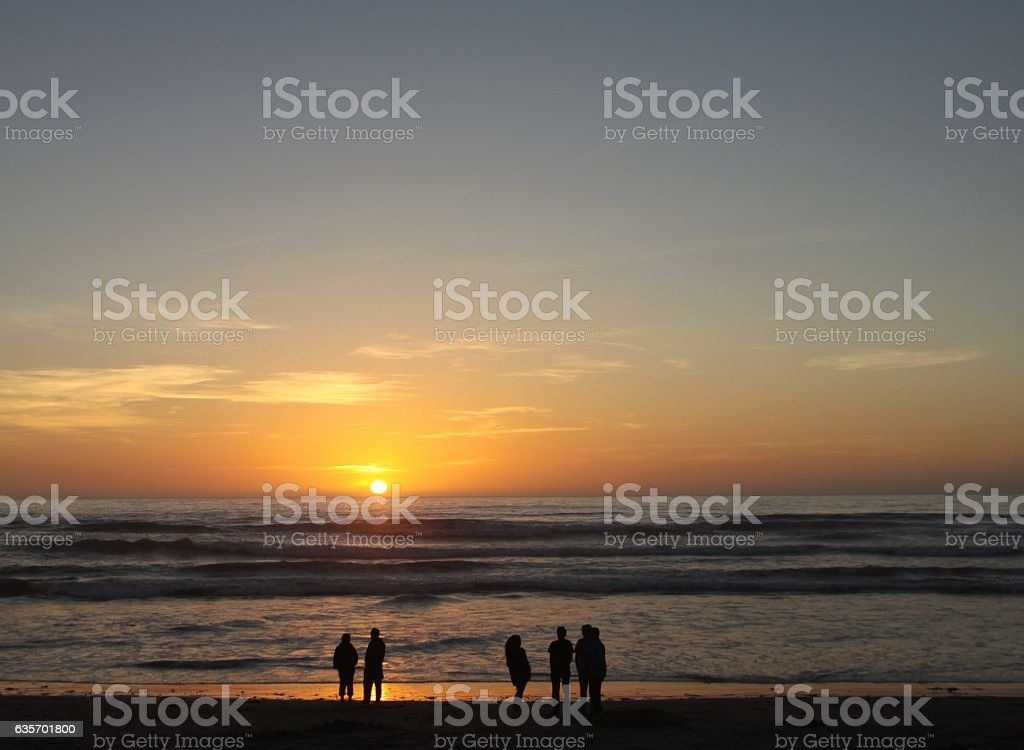 Crowd Of People Enjoying A Pacific Ocean Sunset royalty-free stock photo