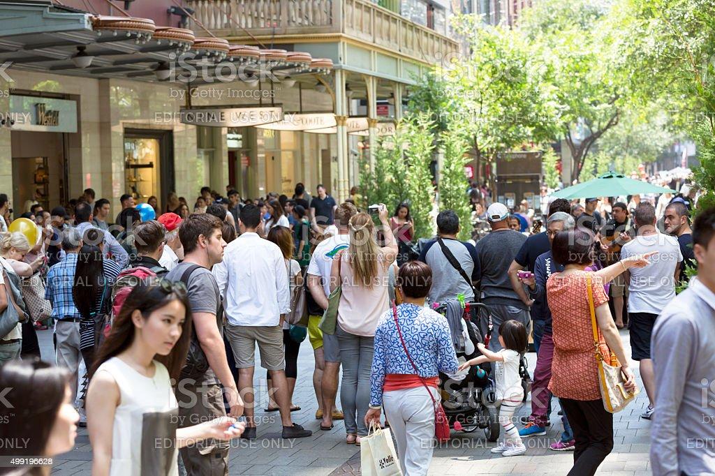 Crowd of people enjoying local musician performing on Pitt Street stock photo