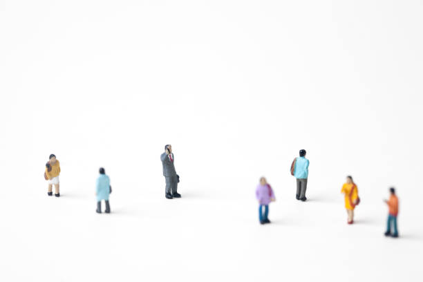 crowd of people in the city - figurine stock photos and pictures