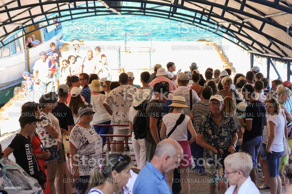 A crowd of people in the shade. royalty-free stock photo