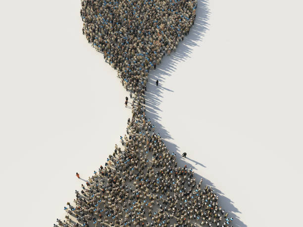 crowd of people in the shape of a hourglass - queue foto e immagini stock