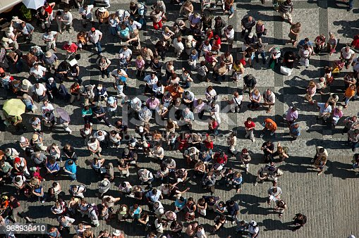 istock Crowd of people in the square in center of the town. 968936410