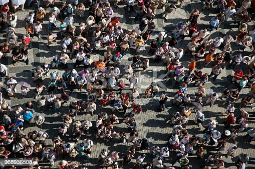 istock Crowd of people in the square in center of the town. 968936508