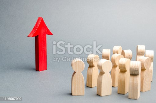 istock A crowd of people looking at the red arrow up. growth and development, self-development. Raising work, raising wages and living standards. Growth of economic indicators. Achievement of success. 1146967920