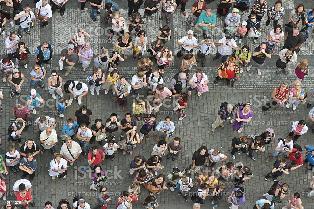 Crowd of people looking up royalty-free stock photo
