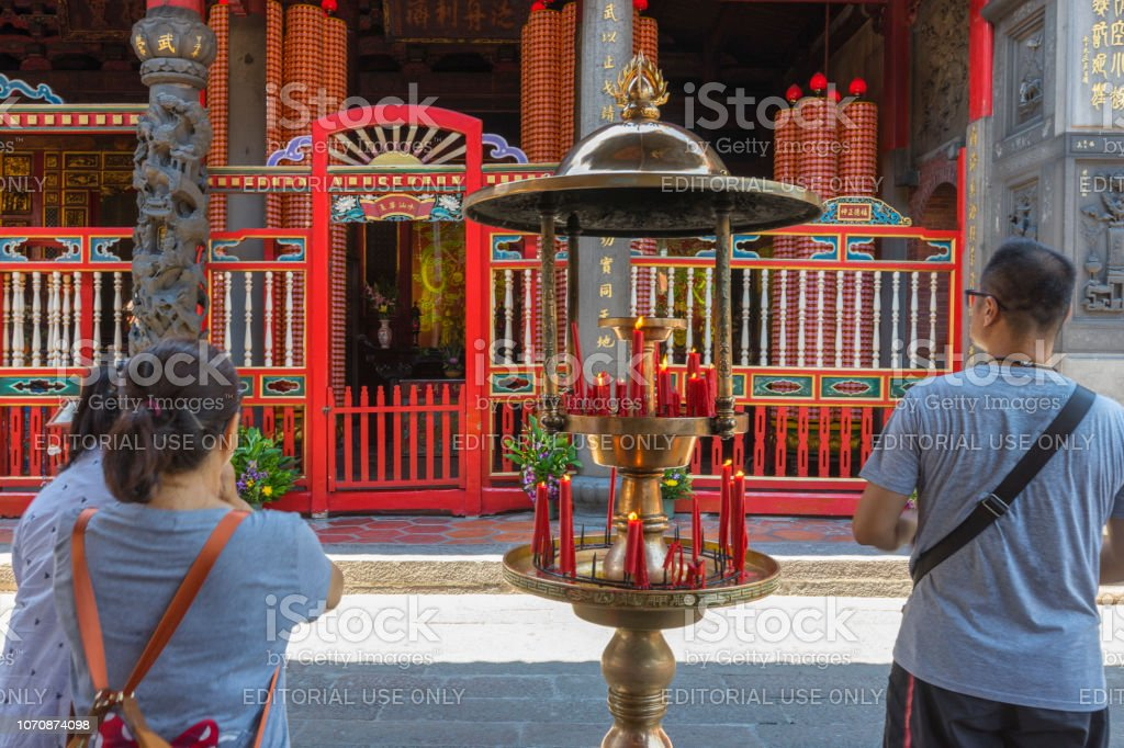 Crowd of people make a pray at Longshan Temple in Taipei, Taiwan on...