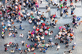 crowd of tourists and Prague residents in front of the Old Town City Hall, Old Town Square, Prague, Czech Republic