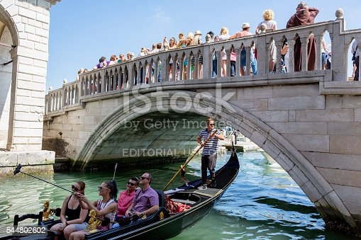Venice, Italy - June 6, 2016: Gondola and crowd of people near the Bridge of Sighs on Riva degli Schiavoni in Venice Italy at day.