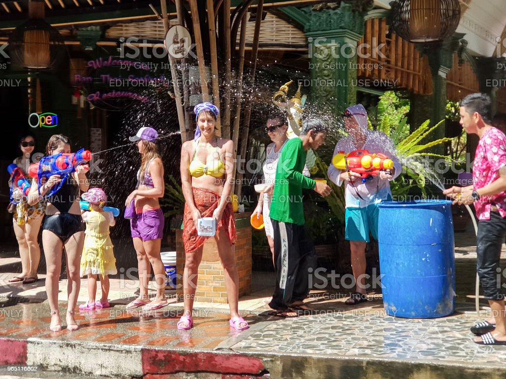 Crowd of People participate in water battle fights with guns, ladles celebrate traditional Thai New Year - Songkran Festival zbiór zdjęć royalty-free