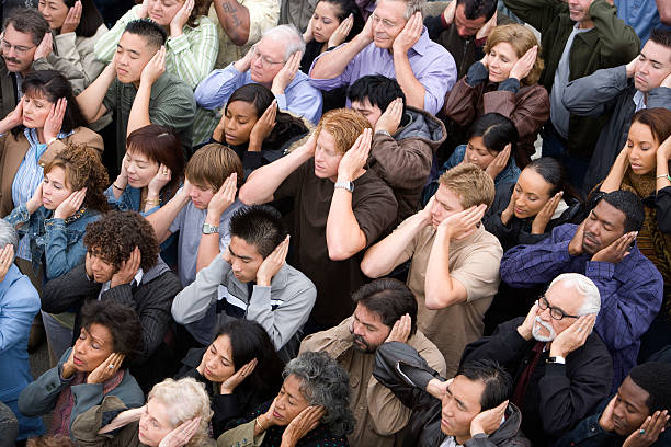 Crowd of people Crowd covering ears hands covering ears stock pictures, royalty-free photos & images