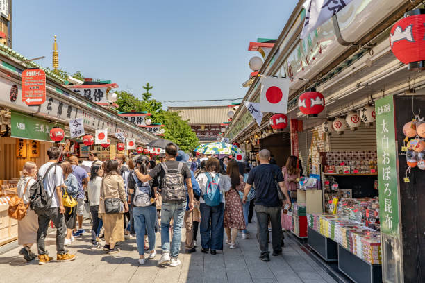 A crowd of people shop along Nakamise Street, the famous market in the historic Asakusa neighborhood. stock photo