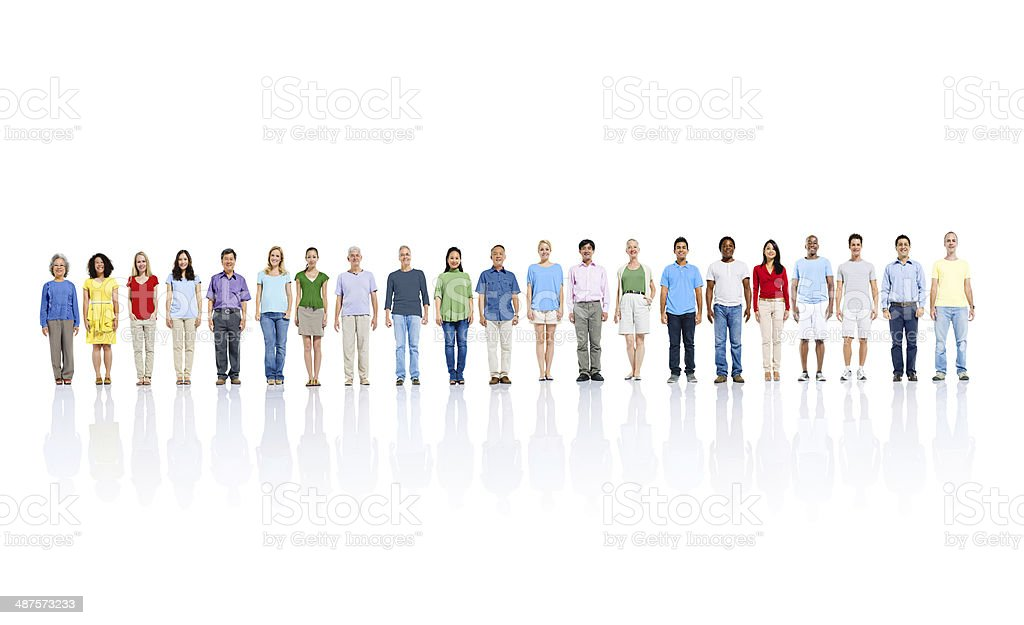 Crowd of people stood in long line stock photo