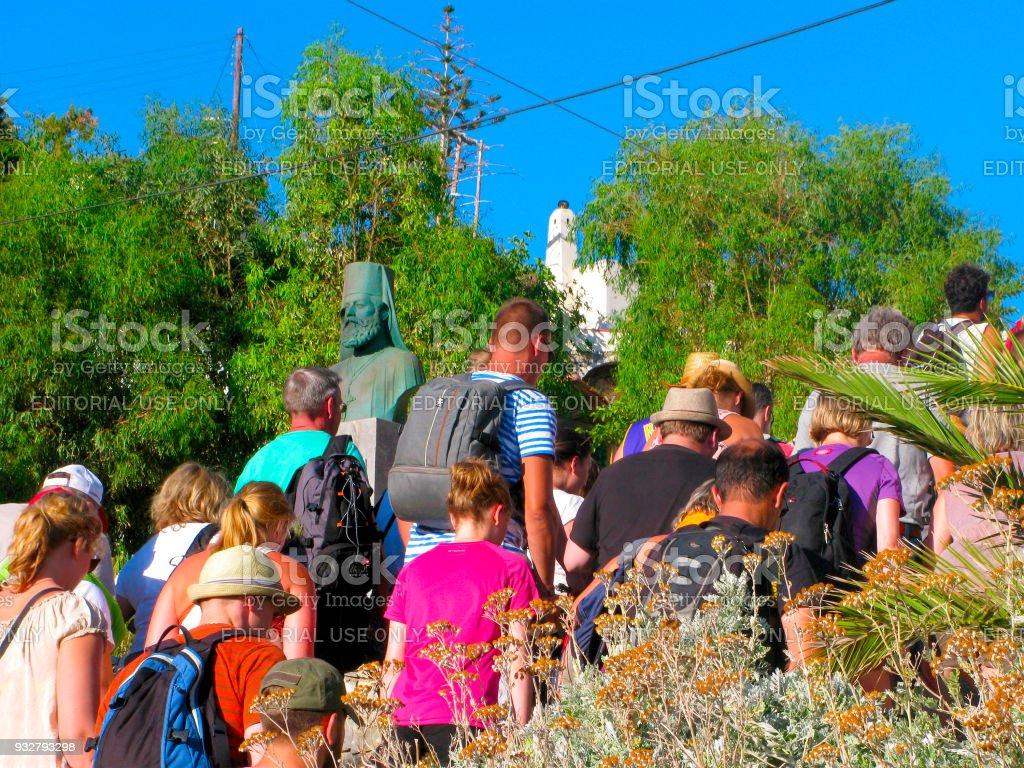 Crowd of people, trip in Samaria gorge, Chora Sfakion, monument to Parthenios Kelaidis stock photo