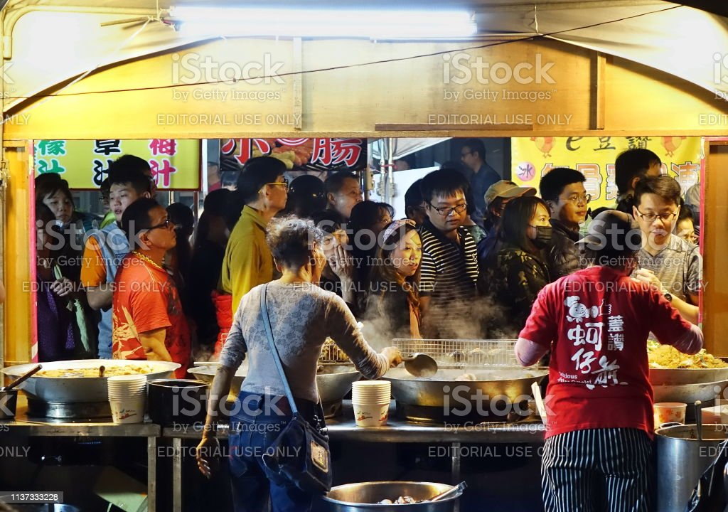 Crowd of People Visit the Food Stalls stock photo
