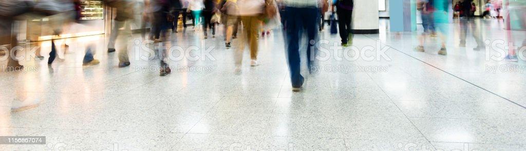 Crowd of people walking at metro station.