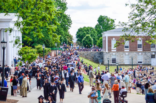 Crowd of people walking by amphitheater at graduation ceremony at University of Virginia Charlottesville: Crowd of people walking by amphitheater at graduation ceremony at University of Virginia charlottesville stock pictures, royalty-free photos & images