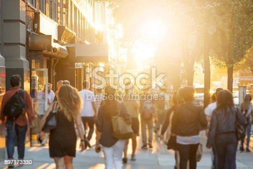 istock Crowd of people walking down sidewalk in Manhattan, New York City 897173330